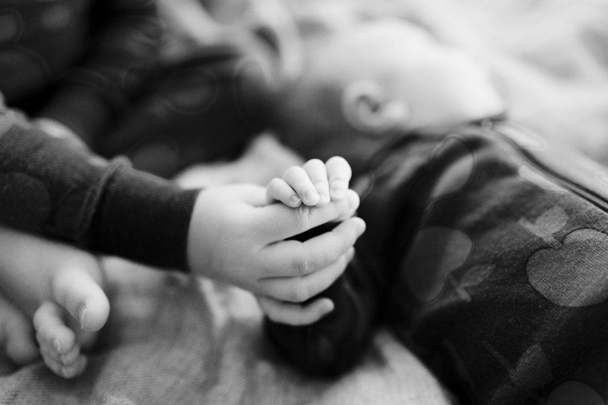Siblings holding hands yoga